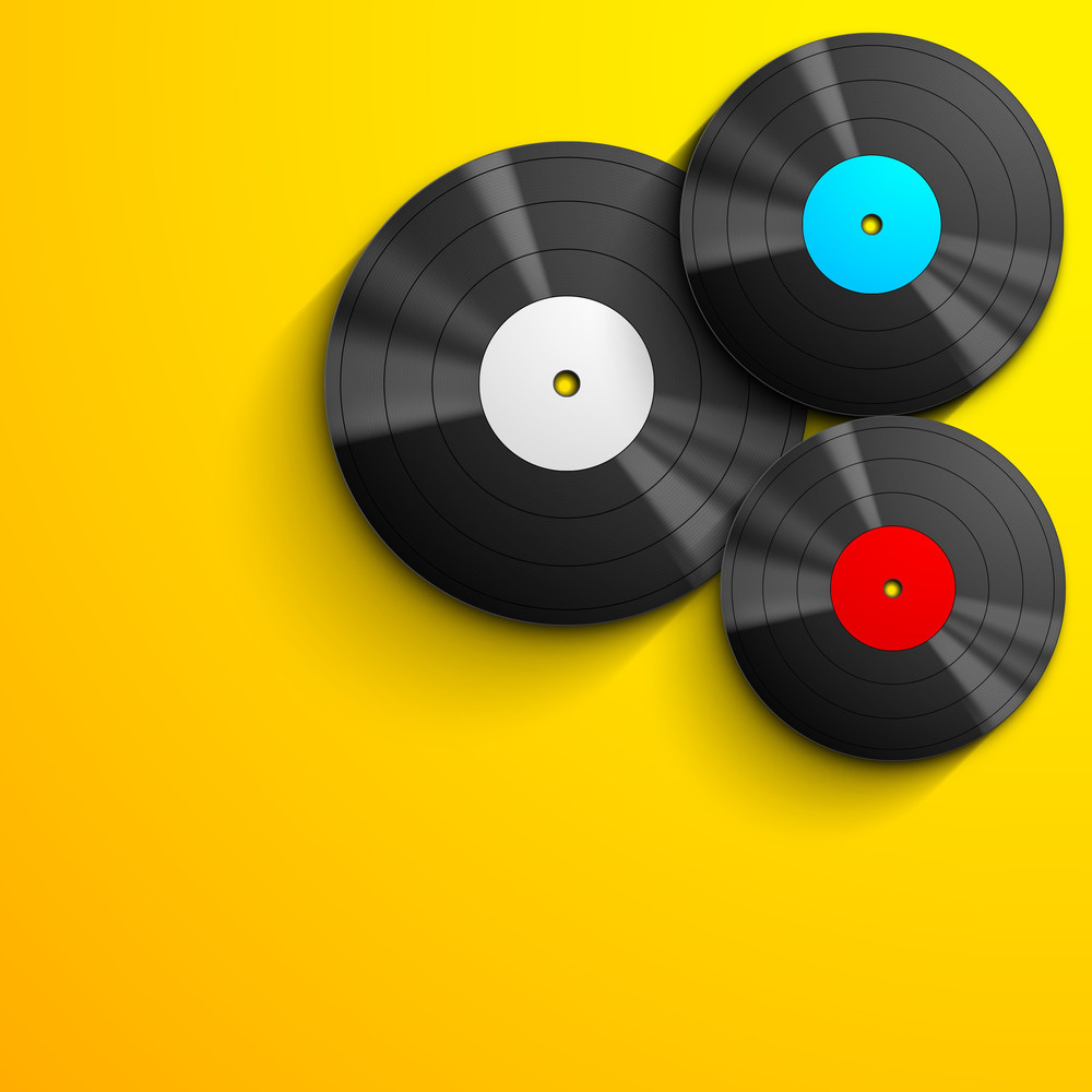 Musical Concept With Vinyl Disc On Yellow Background-