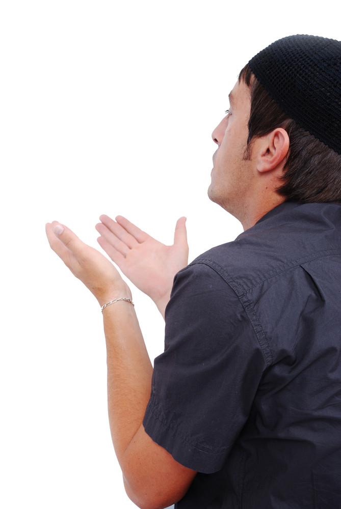 Muslim man is praying on traditional way