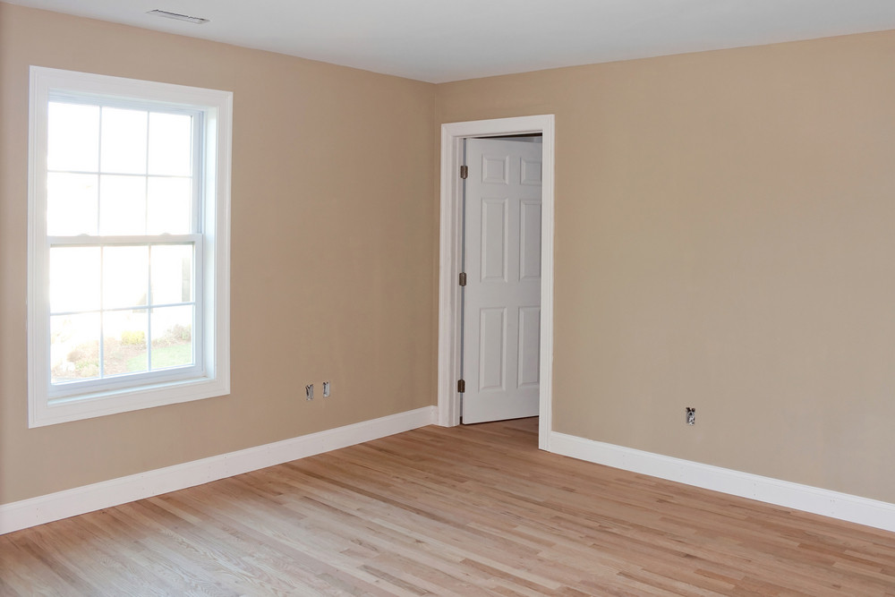 newly constructed house interior room with unfinished wood floors