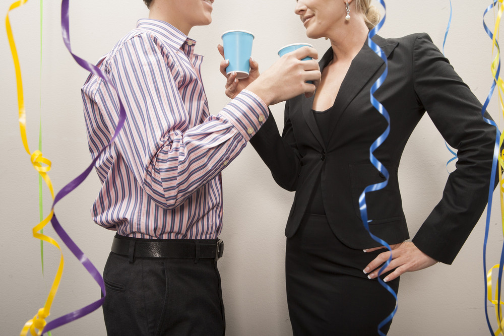 Office people flirting at party
