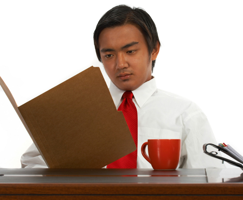 Office Worker Reading A Report