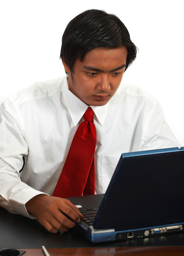 Office Worker Using A Laptop