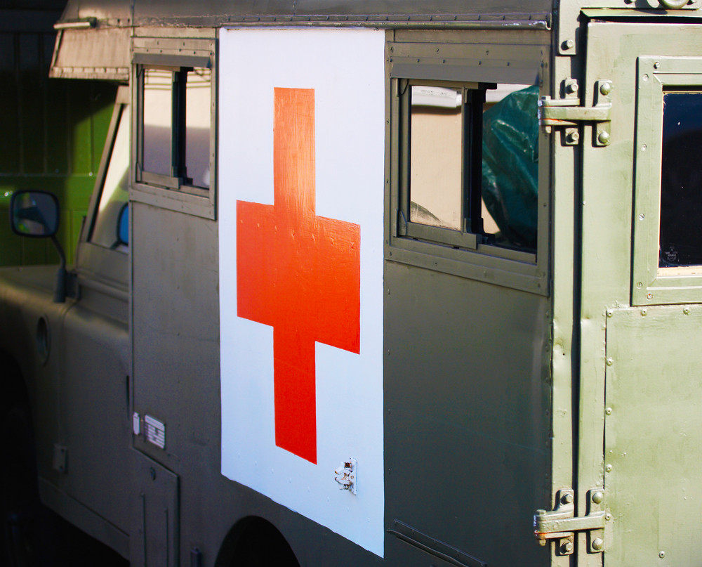 Old Fashioned Ambulance With Red Cross
