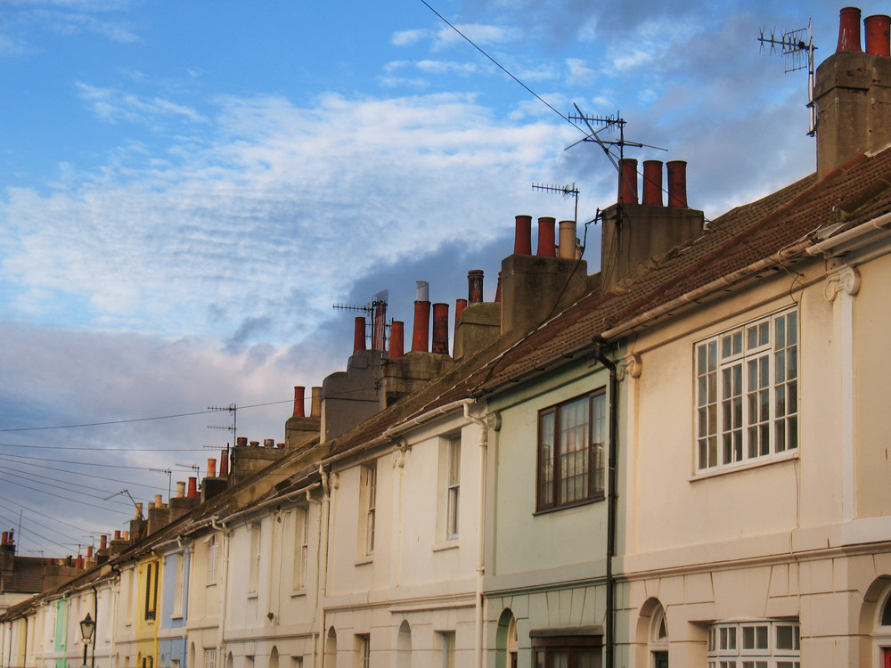 Old Roofs And Frontages Under A Cloudy Blue Sky In Brighton Uk.