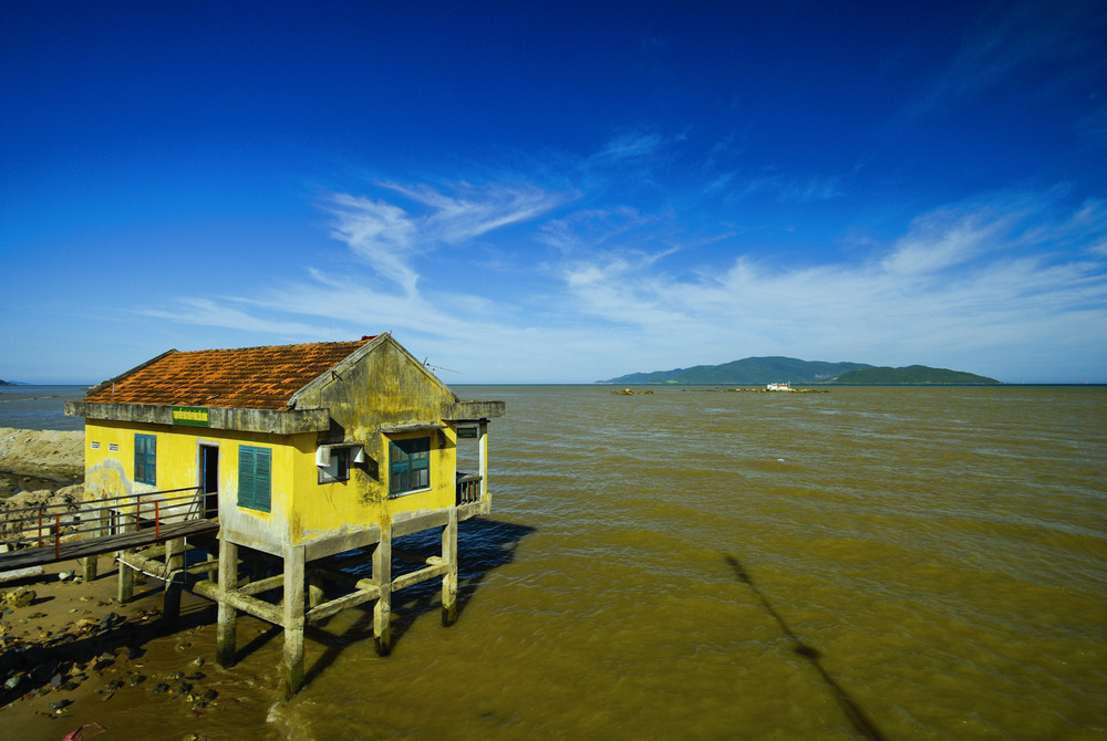 Old yellow house over water in Vietnam