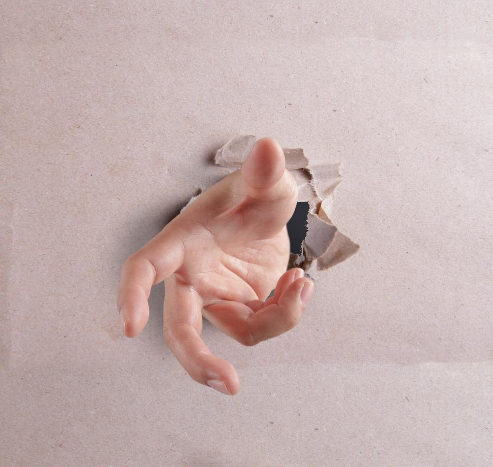 Open Hand Breaking Through Textured