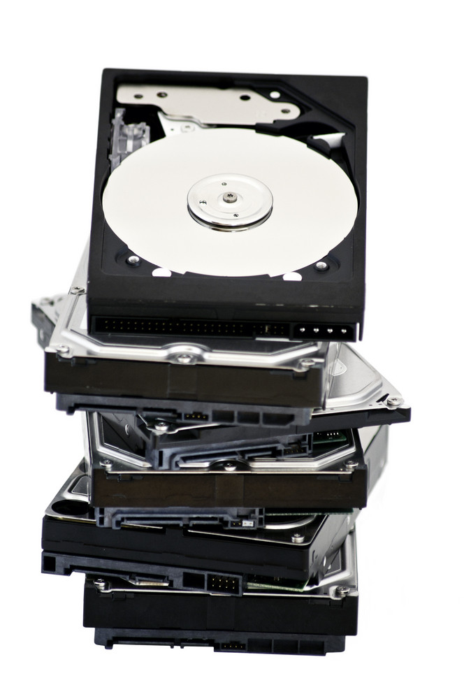 Opened Hard Disk Drive Liying On Other Hard Drive