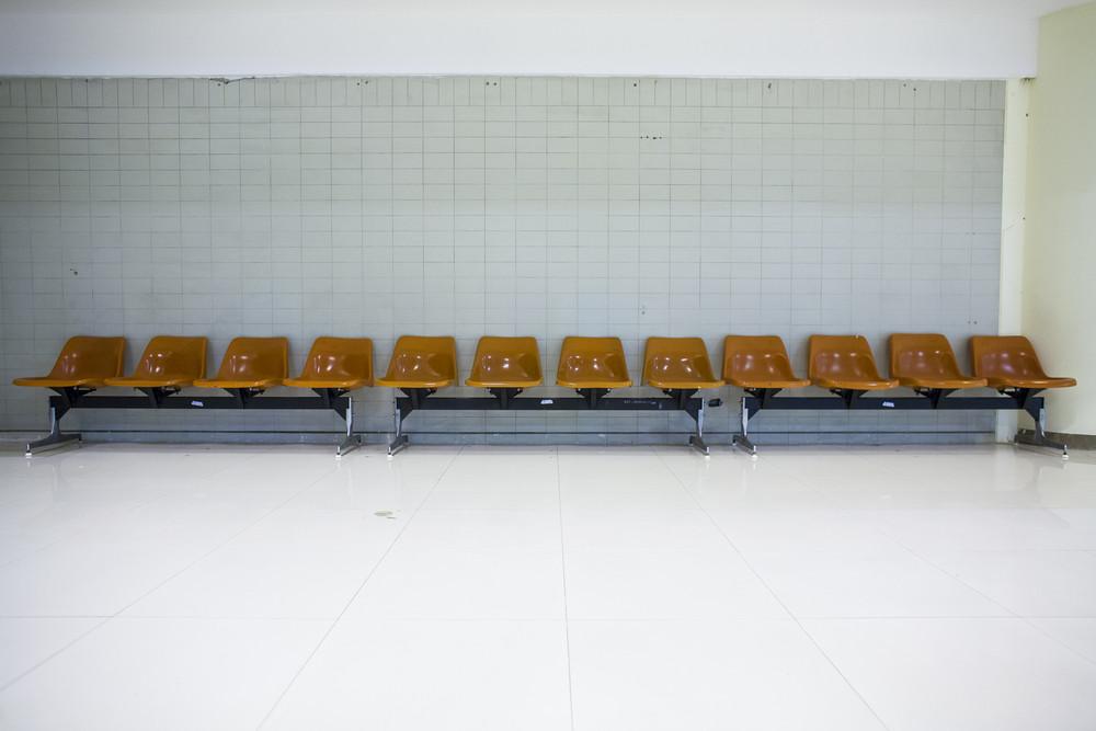 Orange public chairs in airport