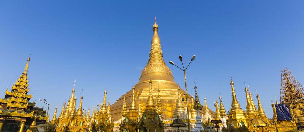 Panorama of Shwedagon pagoda with blue sky. Yangon. Myanmar or Burma.