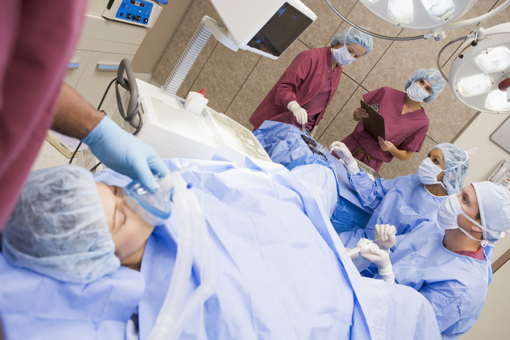 Patient undergoing egg retrieval procedure in theatre