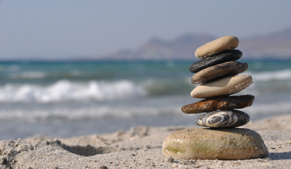 pebble stack on sandy beach