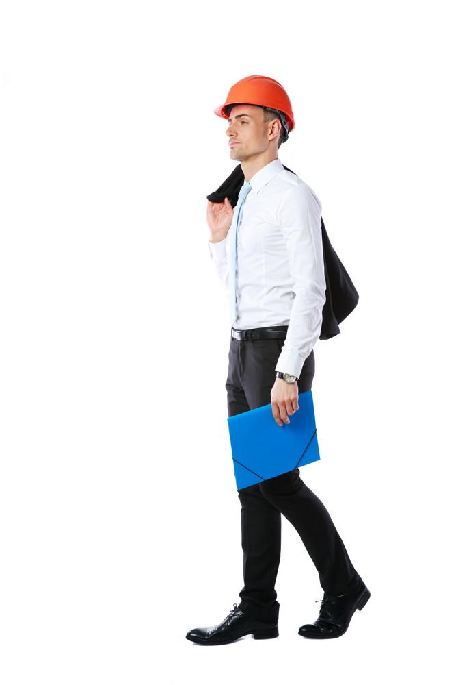 Pensive businessman in helmet with blue folder over white background