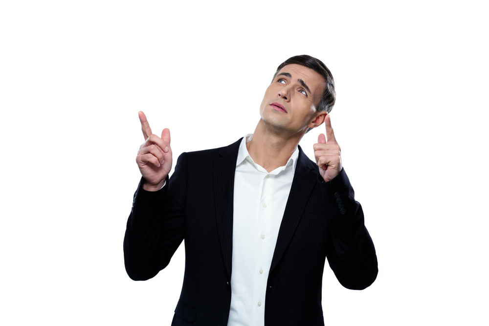 Pensive businessman pointing up with his finger