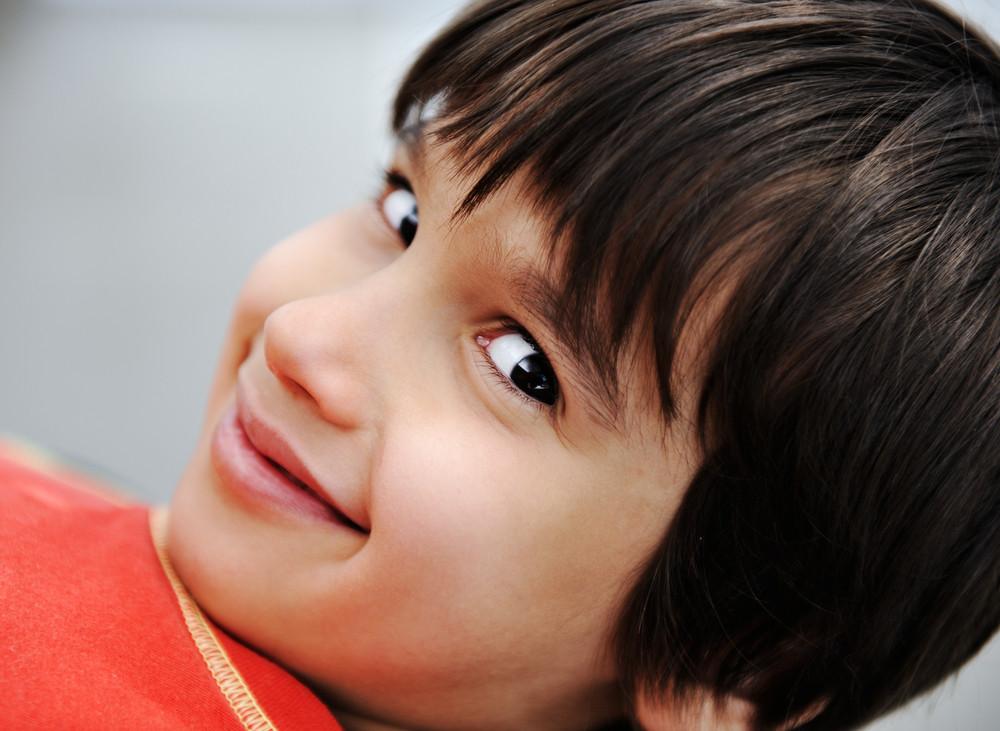 Photo of young boy looking at camera
