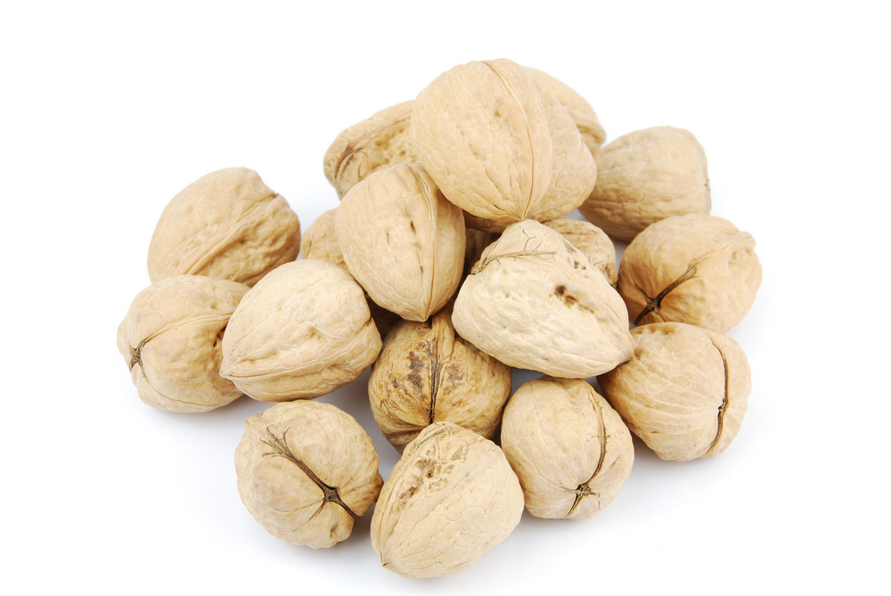 Pile Of Walnuts On White