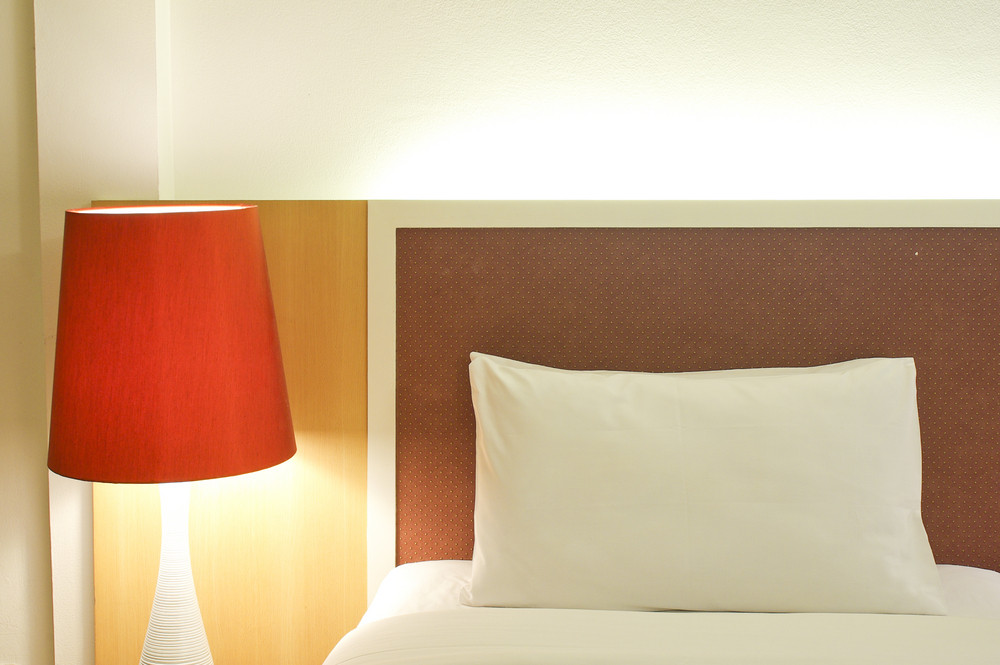 Pillow and Bed in a hotel room at night