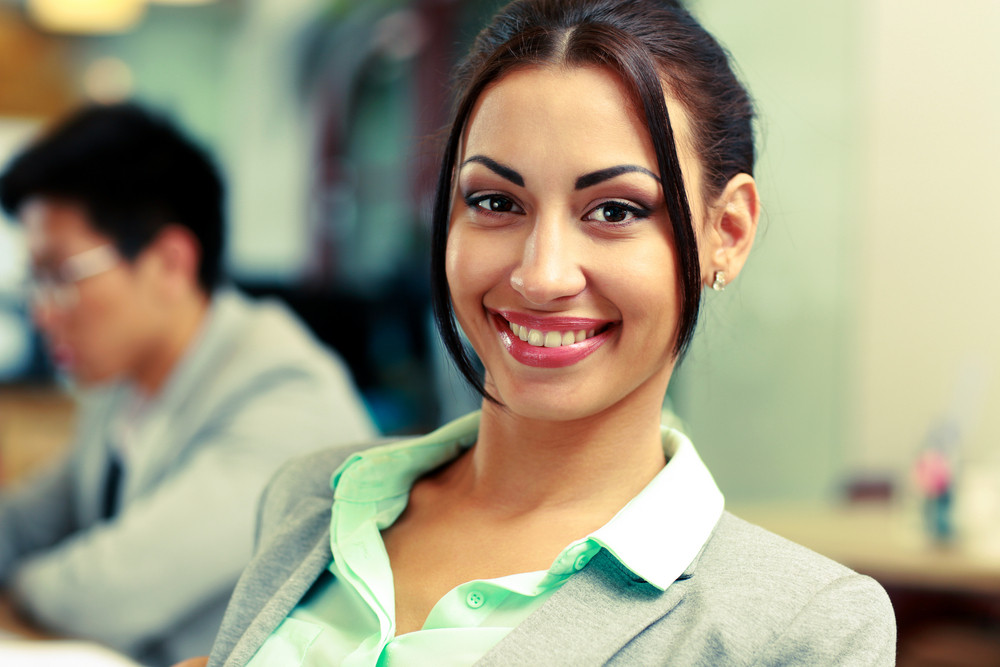 Portrait of a beautiful smiling businesswoman in office