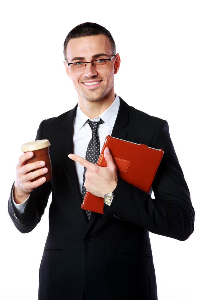 Portrait of a businessman holding cup of coffee and tablet computer over white background