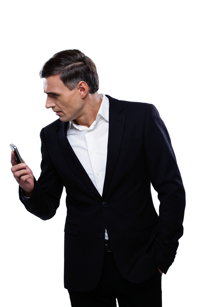 Portrait of a businessman holding smartphone and looking away