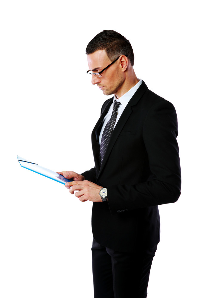 Portrait of a businessman in glasses looking at folder over white background