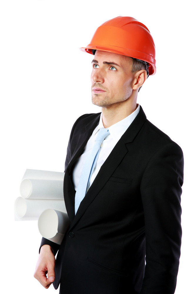 Portrait of a businessman in helmet over white background