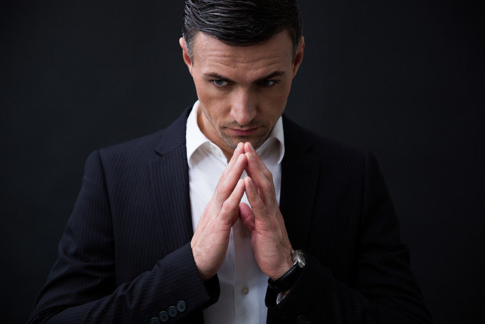 Portrait of a businessman praying