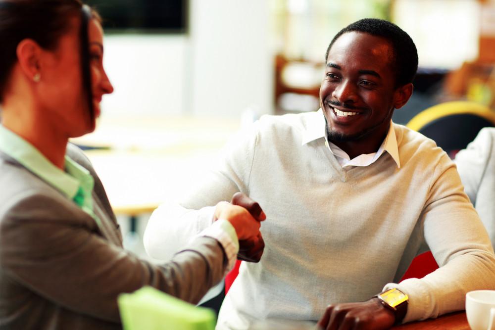 Portrait of a businesspeople handshaking