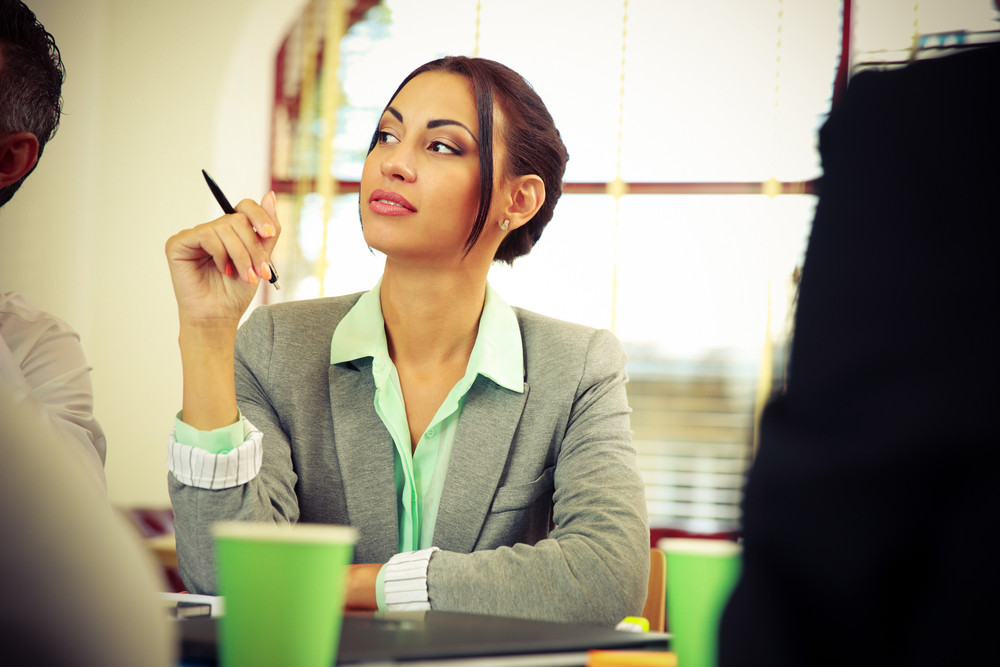 Portrait of a businesswoman sitting at the meeting