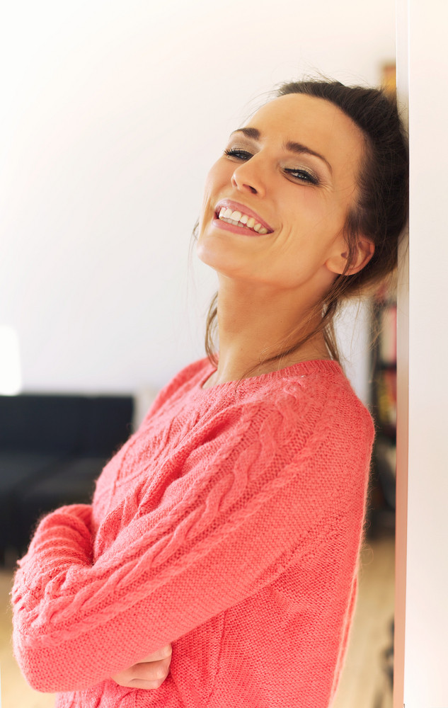 Portrait of a cheerful woman enjoying at home