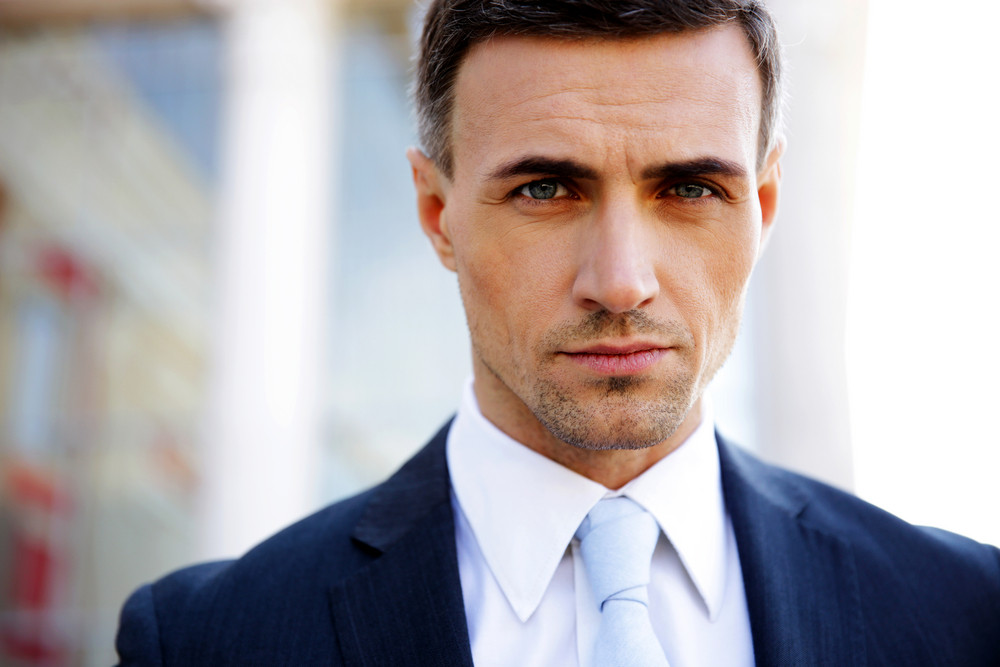 Portrait of a confident businessman looking at camera