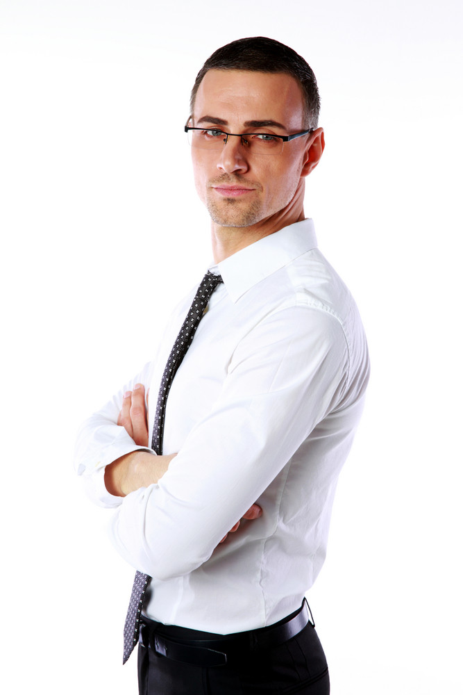 Portrait of a confident businessman with arms folded isolated on a white background