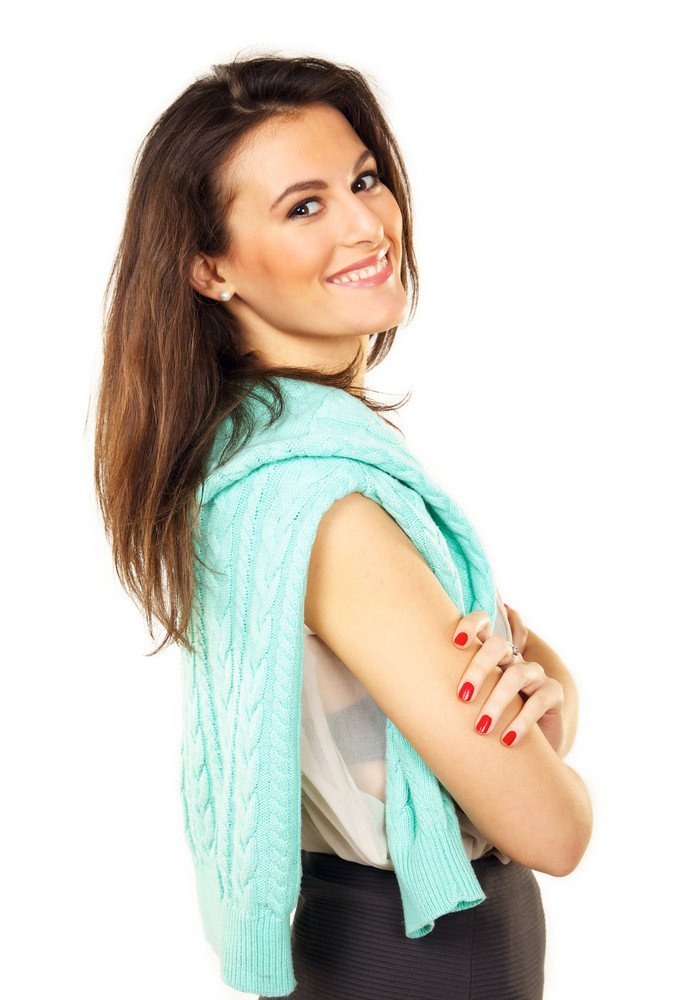 Portrait of a confident young woman with arms folded isolated on white