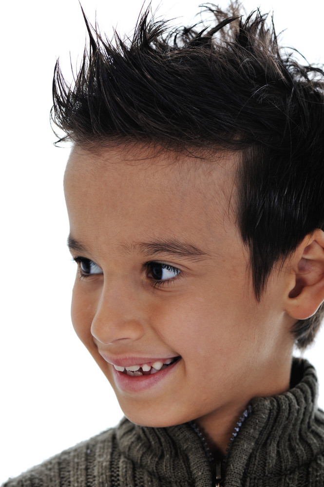 b1206013733 Portrait of a cute little boy smiling on white background Royalty ...