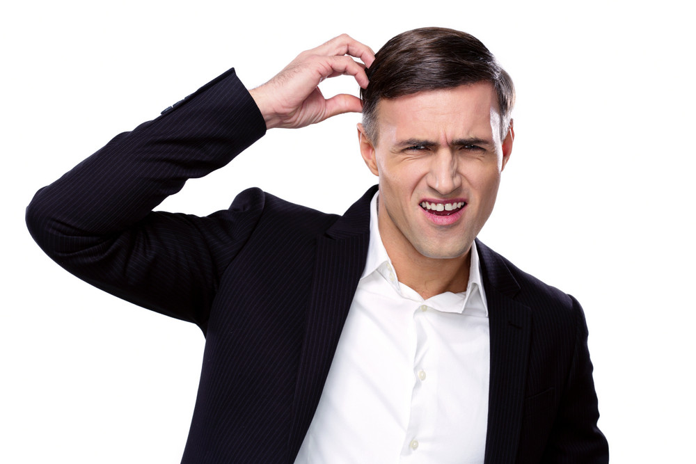 Portrait of a funny businessman over white background