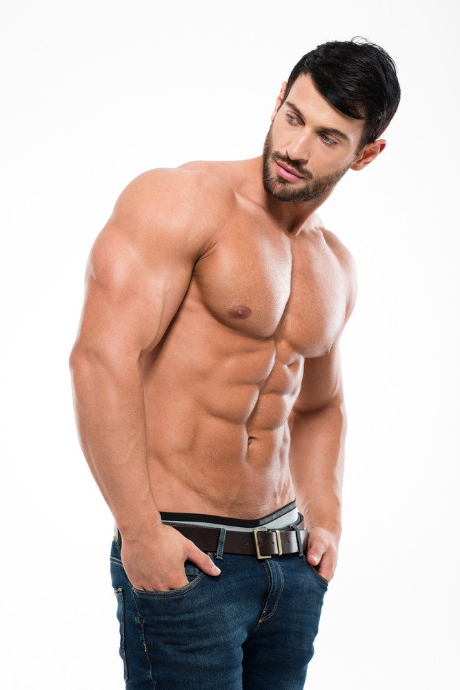 Portrait of a handsome man with muscular body looking away isolated ...
