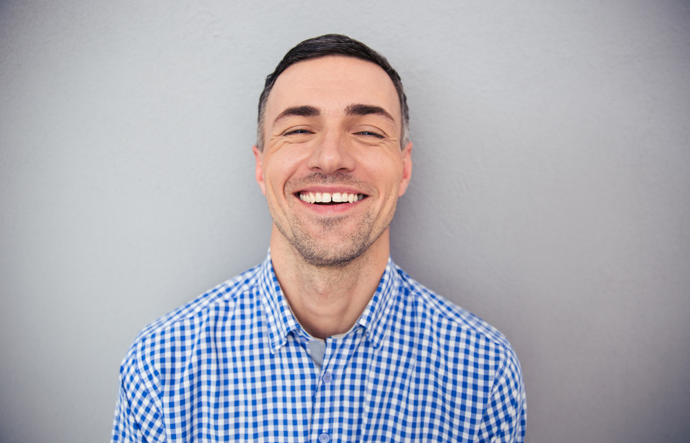 Portrait of a happy man looking at camera