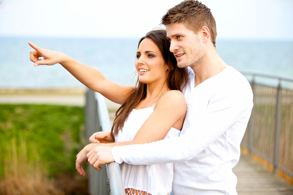 Portrait of a happy young couple dating outdoors