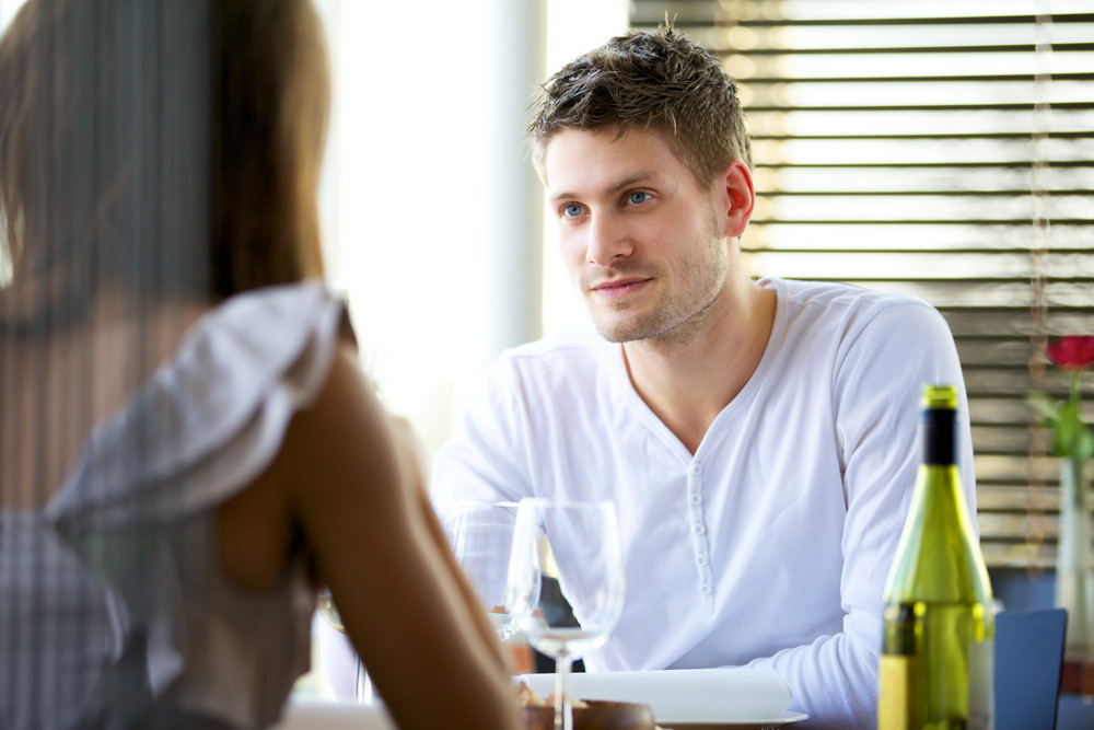 Portrait of a man in a serious conversation with his girlfriend in a restaurant
