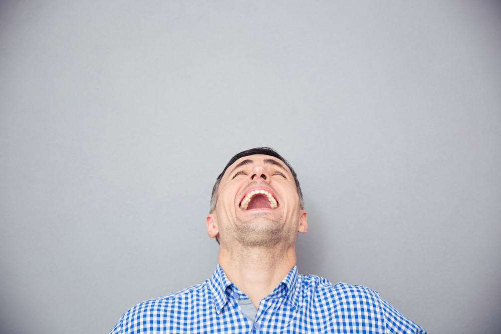 Portrait of a man screaming and looking up