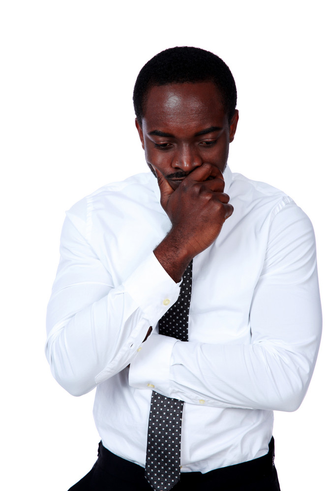 Portrait of a pensive african man isolated on white background