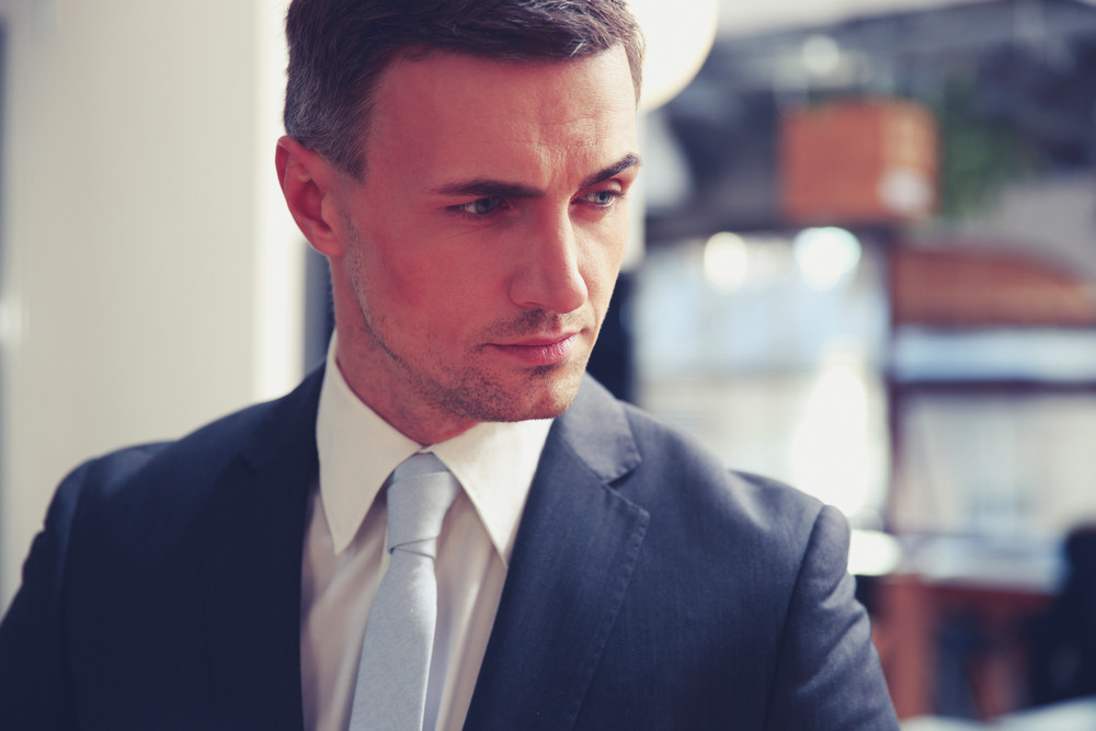 Portrait of a pensive businessman looking away