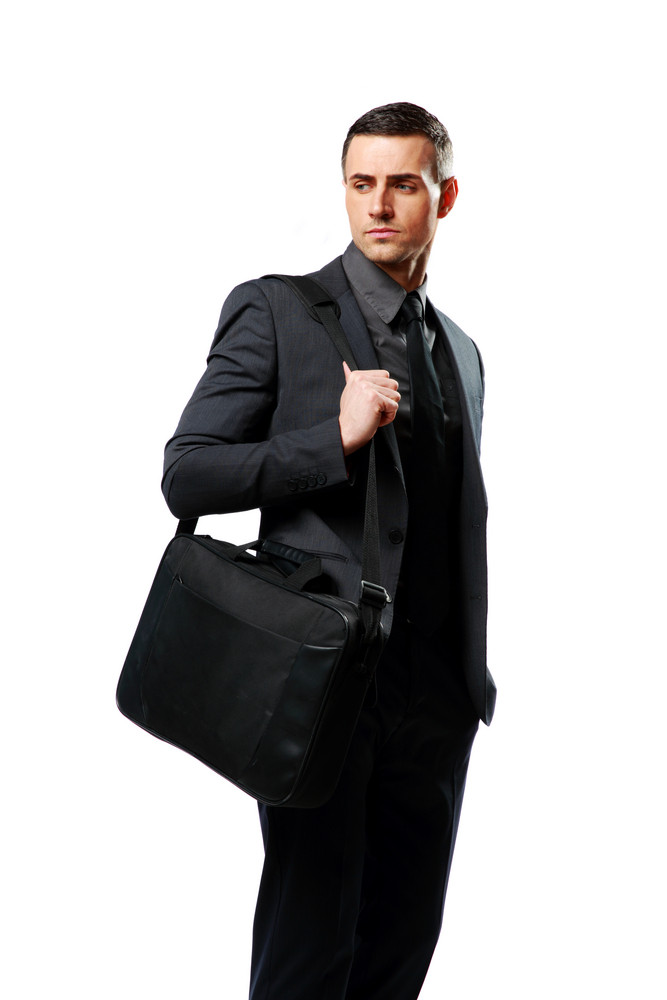 Portrait of a pensive businessman with bag isolated on a white background