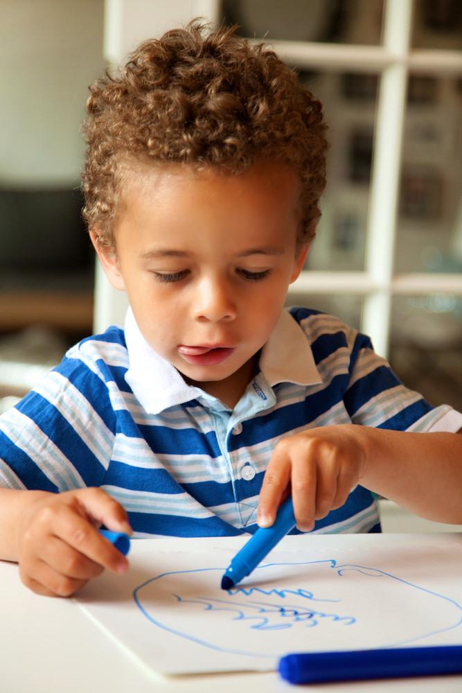 Portrait of a preschooler looking happy after finishing his homework