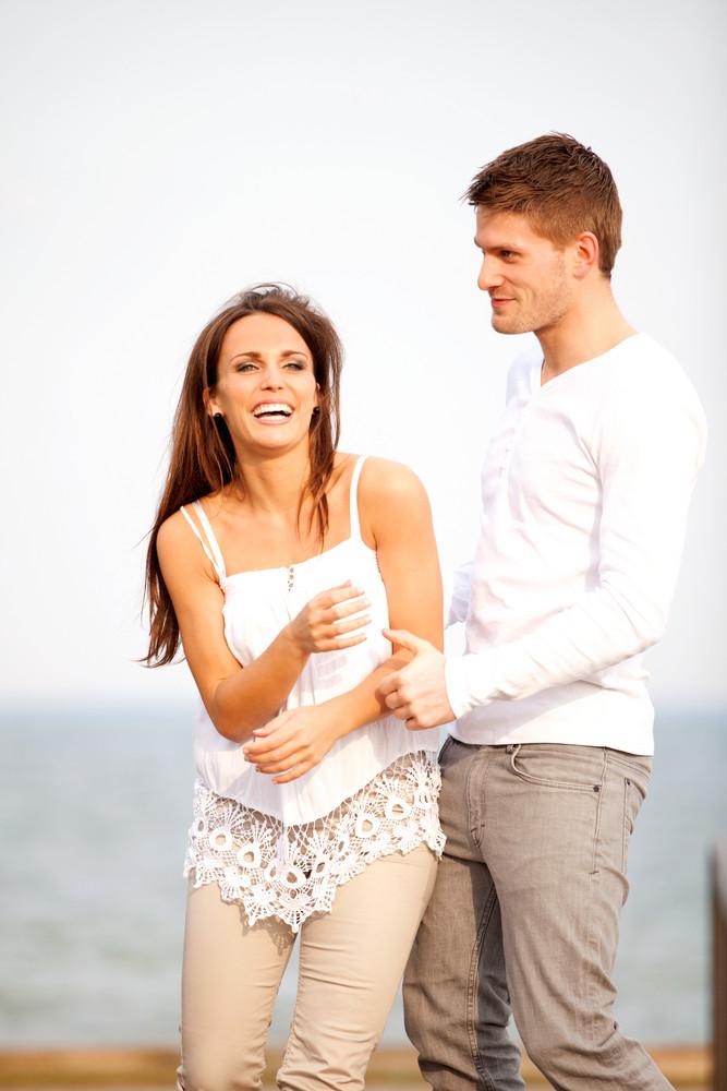 Portrait of a romantic couple having fun outdoors