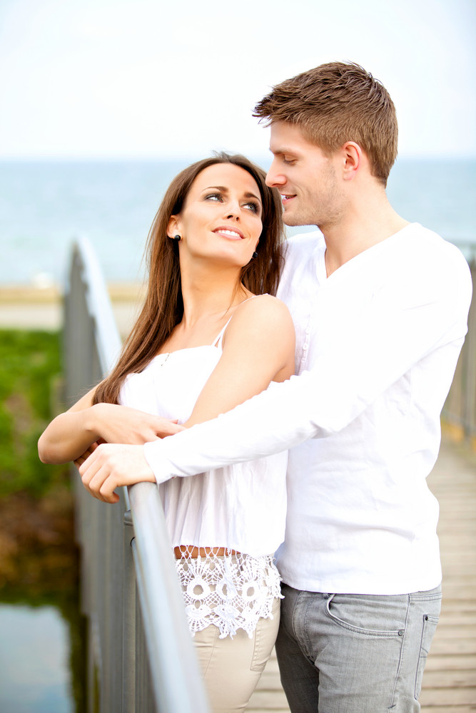 Portrait of a romantic young couple looking at each other while dating outdoors