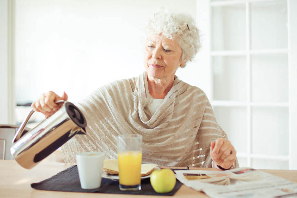 Portrait of a senior woman having healthy breakfast at home