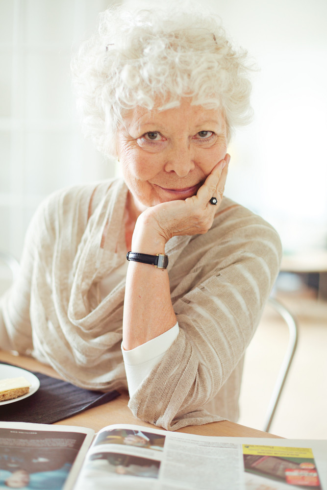 Portrait of a senior woman looking at you with hand on chin