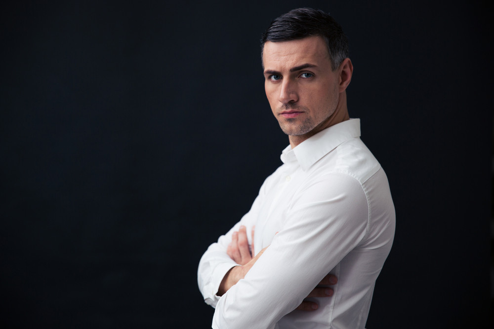 Portrait of a serious businessman with arms folded