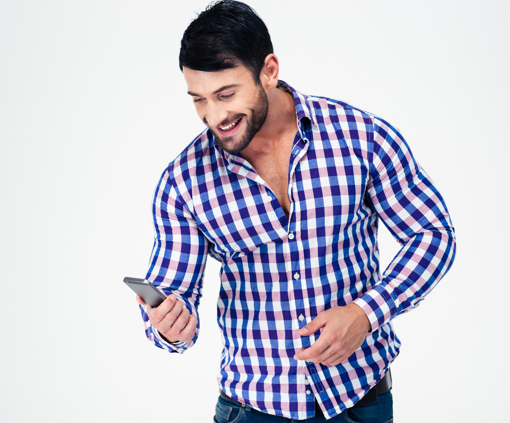 Portrait of a smiling casual man using smartphone