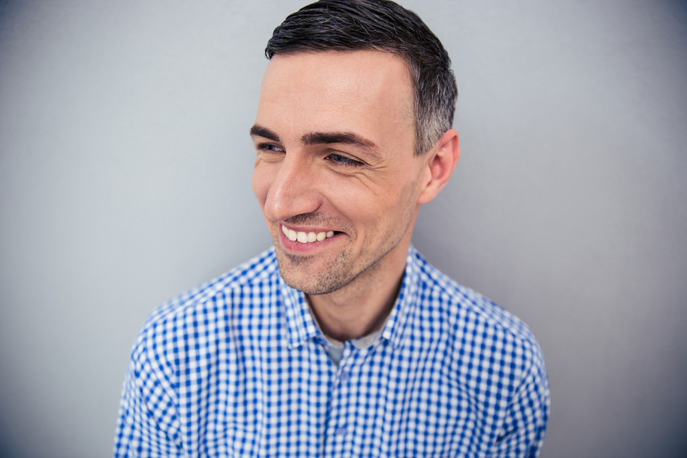 Portrait of a smiling man looking away